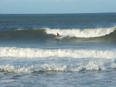 Surf with board rider, breaking waves